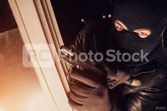 criminal burglar using gun to break into a house at night   : Stock Photo or Stock Video Download rcfotostock photos, images and assets rcfotostock | RC-Photo-Stock.: