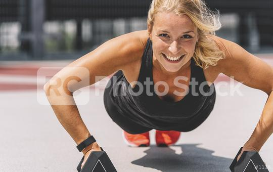 Cross training. Young woman exercising with dumbbells  : Stock Photo or Stock Video Download rcfotostock photos, images and assets rcfotostock | RC-Photo-Stock.: