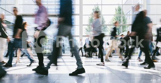Crowd of business people walks by gear on trade fair  : Stock Photo or Stock Video Download rcfotostock photos, images and assets rcfotostock | RC-Photo-Stock.: