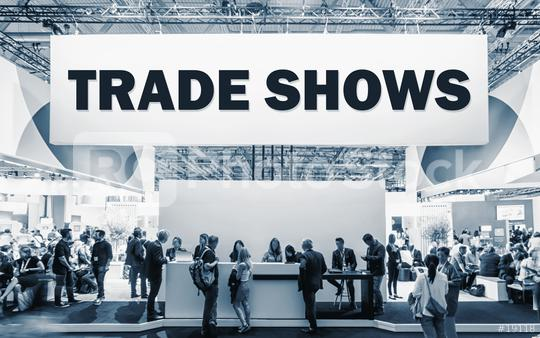 Crowd of people at a trade show booth with a banner and the text Trade Shows.  : Stock Photo or Stock Video Download rcfotostock photos, images and assets rcfotostock | RC-Photo-Stock.: