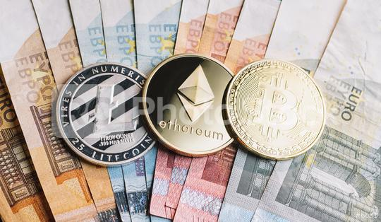 cryptocurrency coins - Litecoin, Bitcoin, Ethereum on top of Euro banknotes  - Buy at rcfotostock this photo and find more royalty-free stock photos,  images, illustrations and vector graphics - RC-PHOTO-STOCK - 6681