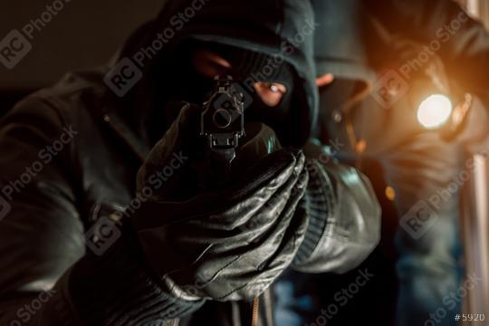dangerous burglar duo with a Gun in his hand  : Stock Photo or Stock Video Download rcfotostock photos, images and assets rcfotostock | RC-Photo-Stock.: