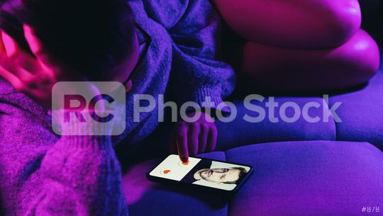 Dating app or site in mobile phone screen. Woman lies on sofa swiping and liking profiles on relationship site or application. Single woman using smartphone to find love, partner and girlfriend.  : Stock Photo or Stock Video Download rcfotostock photos, images and assets rcfotostock | RC-Photo-Stock.: