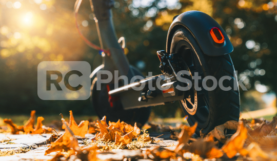 discover the urban city in autumn at sunset with electric scooter or e-scooter, Electric urban transportation concept image  : Stock Photo or Stock Video Download rcfotostock photos, images and assets rcfotostock | RC-Photo-Stock.: