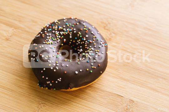 donut with chocolate glazed and sprinkles  : Stock Photo or Stock Video Download rcfotostock photos, images and assets rcfotostock | RC-Photo-Stock.: