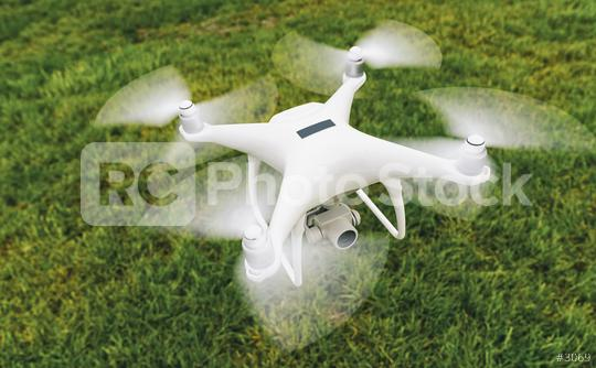 Drone with camera and black plaque over a green meadow  : Stock Photo or Stock Video Download rcfotostock photos, images and assets rcfotostock   RC-Photo-Stock.: