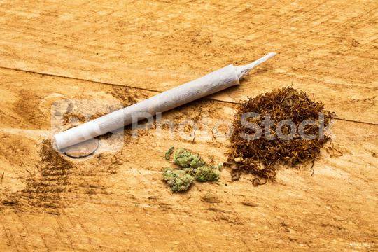 Drugs of marijuana with joint and tobacco  : Stock Photo or Stock Video Download rcfotostock photos, images and assets rcfotostock | RC-Photo-Stock.: