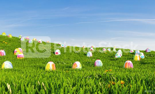 Easter background. Easter eggs laying in green grass under blue sky, including Copy Space  : Stock Photo or Stock Video Download rcfotostock photos, images and assets rcfotostock   RC-Photo-Stock.: