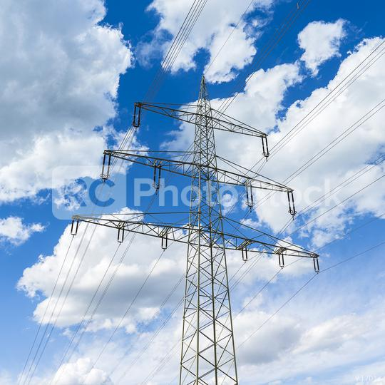 electricity pylon on blue cloudy sky industry high voltage  : Stock Photo or Stock Video Download rcfotostock photos, images and assets rcfotostock   RC-Photo-Stock.: