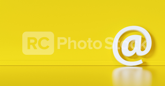 Email Icon or at sign leaning against a yellow wall as a communication concept  : Stock Photo or Stock Video Download rcfotostock photos, images and assets rcfotostock | RC-Photo-Stock.: