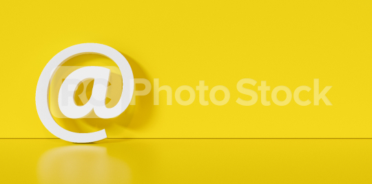 Email Icon or at sign leaning against a yellow wall as a communication concept, copyspace for your individual text.   : Stock Photo or Stock Video Download rcfotostock photos, images and assets rcfotostock   RC-Photo-Stock.: