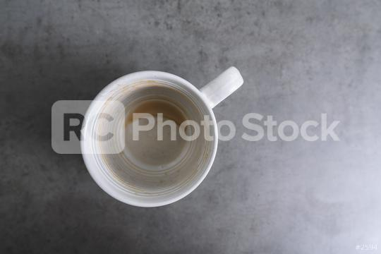 Empty coffee cup after drink on gray table  : Stock Photo or Stock Video Download rcfotostock photos, images and assets rcfotostock | RC-Photo-Stock.: