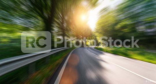 Empty long mountain road to the horizon on a sunny summer day at bright sunset with motion blur, Backplate or Backdrop background.  : Stock Photo or Stock Video Download rcfotostock photos, images and assets rcfotostock   RC-Photo-Stock.: