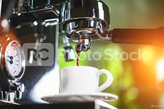Espresso out of classic coffee machine into coffee cup  : Stock Photo or Stock Video Download rcfotostock photos, images and assets rcfotostock   RC-Photo-Stock.: