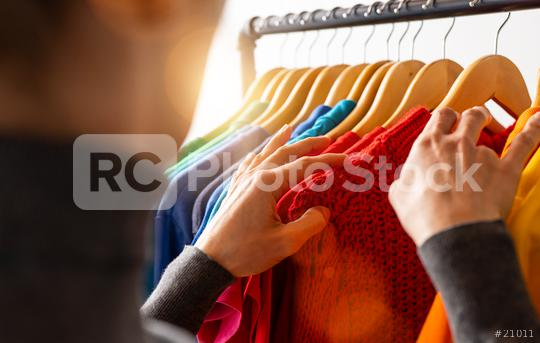 Fashion clothes hanging on clothing rack, in colorful rainbow colors selection of clothes closet. Woman choose outfits on hangers in store closet. LGBT colors  : Stock Photo or Stock Video Download rcfotostock photos, images and assets rcfotostock   RC-Photo-Stock.: