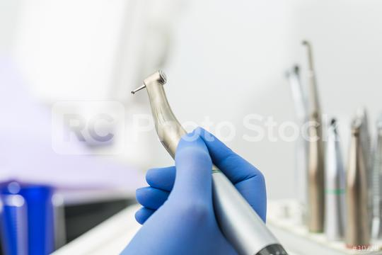 female Dentist doctor hand holding dentist tools in Dentist Clinic  : Stock Photo or Stock Video Download rcfotostock photos, images and assets rcfotostock | RC-Photo-Stock.: