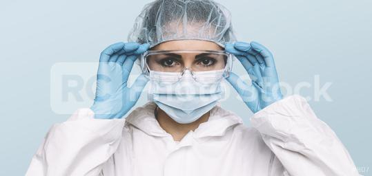 Female Doctor or Nurse Wearing latex protective gloves and medical Protective Mask and glasses on face. Protection for Coronavirus COVID-19  : Stock Photo or Stock Video Download rcfotostock photos, images and assets rcfotostock | RC-Photo-Stock.: