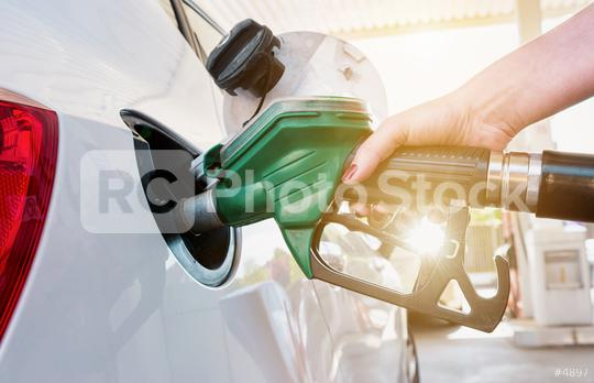 female hand refilling the car with fuel on a filling station  : Stock Photo or Stock Video Download rcfotostock photos, images and assets rcfotostock | RC-Photo-Stock.: