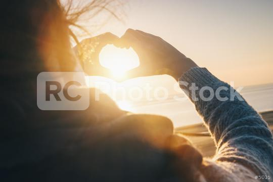 Female hands in the form of heart against sunlight at sunset on   : Stock Photo or Stock Video Download rcfotostock photos, images and assets rcfotostock | RC-Photo-Stock.: