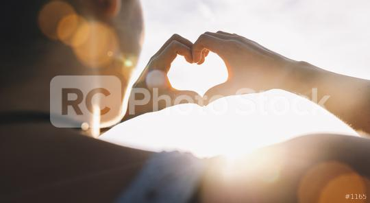 Female hands in the form of heart against the sky pass sun beams. Hands in shape of love heart  : Stock Photo or Stock Video Download rcfotostock photos, images and assets rcfotostock | RC-Photo-Stock.: