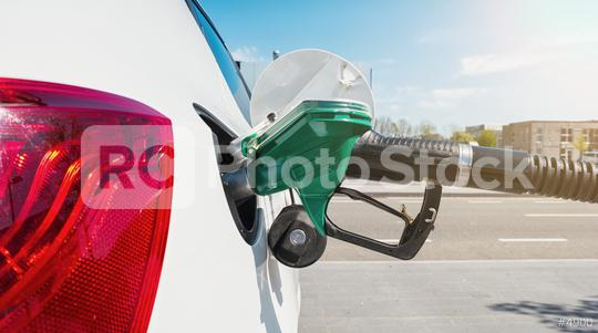 Fill the gas tank eco car self service  : Stock Photo or Stock Video Download rcfotostock photos, images and assets rcfotostock | RC-Photo-Stock.:
