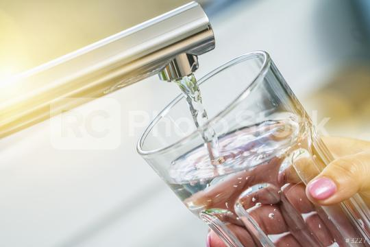 filling glass with drinkable water  : Stock Photo or Stock Video Download rcfotostock photos, images and assets rcfotostock | RC-Photo-Stock.: