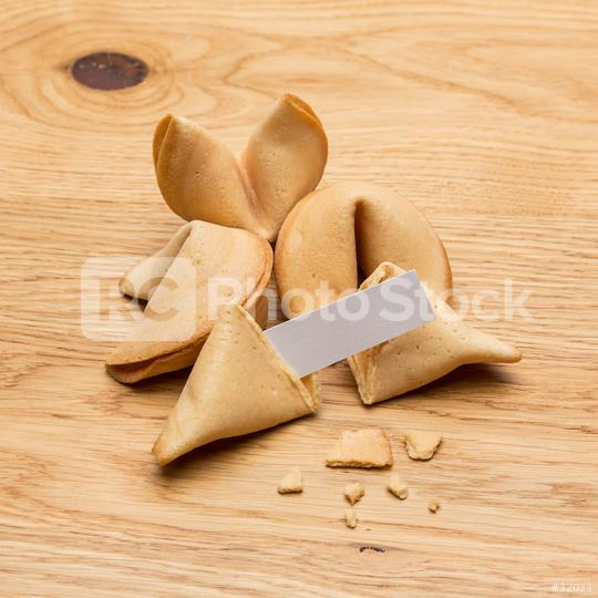 fortune cookies with a note on wooden table  : Stock Photo or Stock Video Download rcfotostock photos, images and assets rcfotostock | RC-Photo-Stock.: