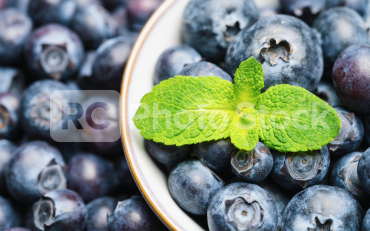 Fresh blueberries in a bowl with mint leaf background or backdrop. Vegan and vegetarian concept. Macro texture of blueberry berries. Summer healthy food.   : Stock Photo or Stock Video Download rcfotostock photos, images and assets rcfotostock | RC-Photo-Stock.:
