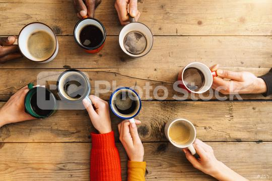 Friends group drinking coffee and cappuccino in a bar or restaurant - People hands cheering and toasting on top view point - breakfast together concept with white and black men and women  : Stock Photo or Stock Video Download rcfotostock photos, images and assets rcfotostock | RC-Photo-Stock.: