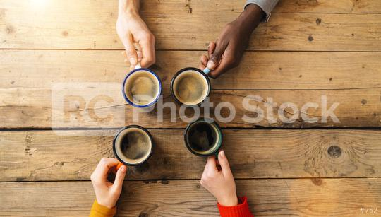 Friends group drinking coffee in a bar restaurant - People hands cheering and toasting on top view point - Social gathering concept with white and black men and women together  : Stock Photo or Stock Video Download rcfotostock photos, images and assets rcfotostock | RC-Photo-Stock.: