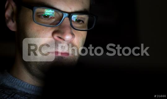Gambling addicted man with glasses in front of online casino slot machine on laptop computer at night - loosing his money. Dramatic low light grain shot.  : Stock Photo or Stock Video Download rcfotostock photos, images and assets rcfotostock | RC-Photo-Stock.:
