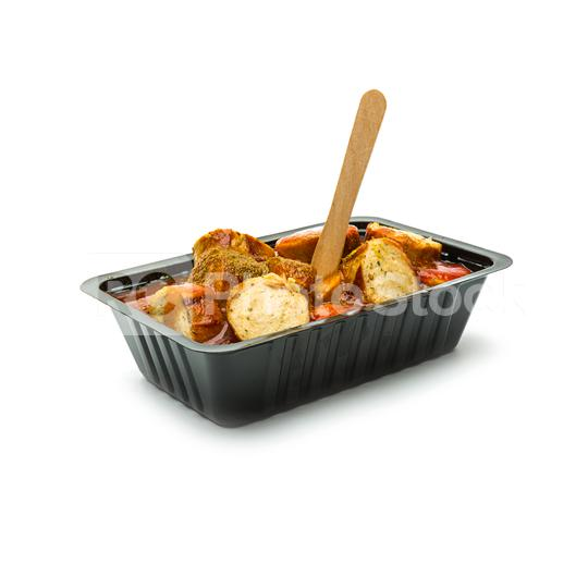 german currywurst in a black shell  : Stock Photo or Stock Video Download rcfotostock photos, images and assets rcfotostock | RC-Photo-Stock.: