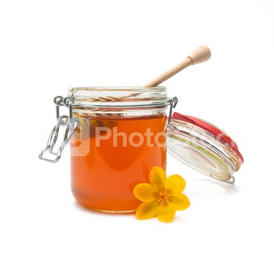 Glass jar of bio honey with honey dipper  : Stock Photo or Stock Video Download rcfotostock photos, images and assets rcfotostock | RC-Photo-Stock.: