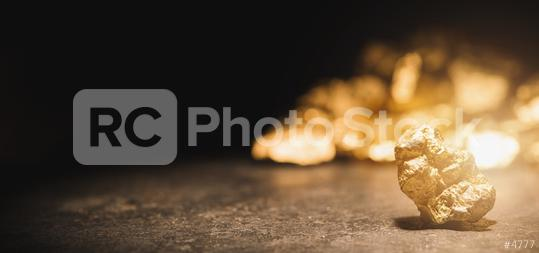 gold nugget in front of a mound of gold  : Stock Photo or Stock Video Download rcfotostock photos, images and assets rcfotostock | RC-Photo-Stock.: