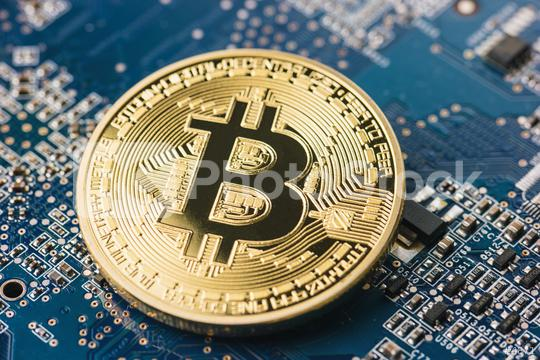 Golden bitcoin on mainboard surface  : Stock Photo or Stock Video Download rcfotostock photos, images and assets rcfotostock | RC-Photo-Stock.: