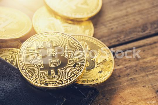 Golden Bitcoins - New virtual money in a wallet  : Stock Photo or Stock Video Download rcfotostock photos, images and assets rcfotostock | RC-Photo-Stock.:
