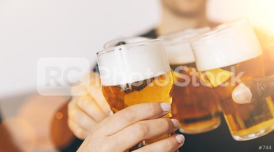 Group of friends enjoying a beer   : Stock Photo or Stock Video Download rcfotostock photos, images and assets rcfotostock | RC-Photo-Stock.: