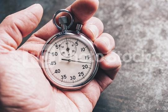 hand holding chronometer  : Stock Photo or Stock Video Download rcfotostock photos, images and assets rcfotostock   RC-Photo-Stock.: