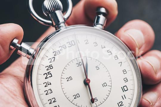 hand holding stopwatch  : Stock Photo or Stock Video Download rcfotostock photos, images and assets rcfotostock | RC-Photo-Stock.: