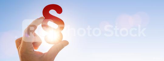 Hand holds paragraph symbol in the sun so the sky, copyspace for your individual text, banner size  : Stock Photo or Stock Video Download rcfotostock photos, images and assets rcfotostock | RC-Photo-Stock.: