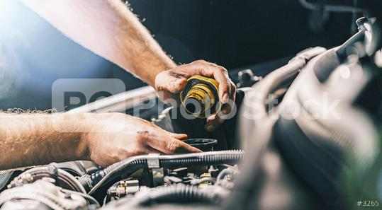 Hand mechanic in repairing car,Change the Oil  : Stock Photo or Stock Video Download rcfotostock photos, images and assets rcfotostock   RC-Photo-Stock.: