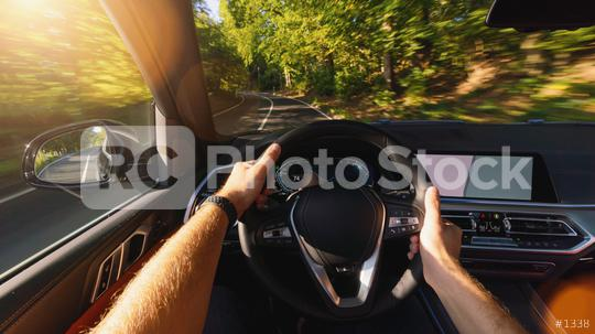 hands of car driver on steering wheel, road trip, driving on forest road  : Stock Photo or Stock Video Download rcfotostock photos, images and assets rcfotostock | RC-Photo-Stock.: