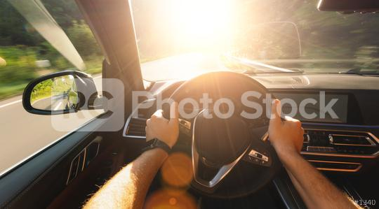 hands of car driver on steering wheel, road trip, driving on forest road with bright sunlight  : Stock Photo or Stock Video Download rcfotostock photos, images and assets rcfotostock   RC-Photo-Stock.: