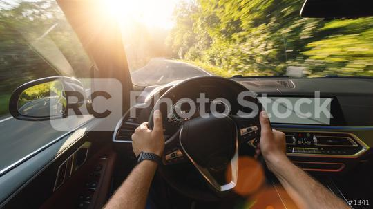 hands of car driver on steering wheel, road trip, driving on forest road  : Stock Photo or Stock Video Download rcfotostock photos, images and assets rcfotostock   RC-Photo-Stock.: