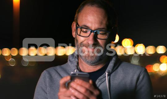 Handsome mature man speaking on smart phone at autumn sunset in city  : Stock Photo or Stock Video Download rcfotostock photos, images and assets rcfotostock | RC-Photo-Stock.: