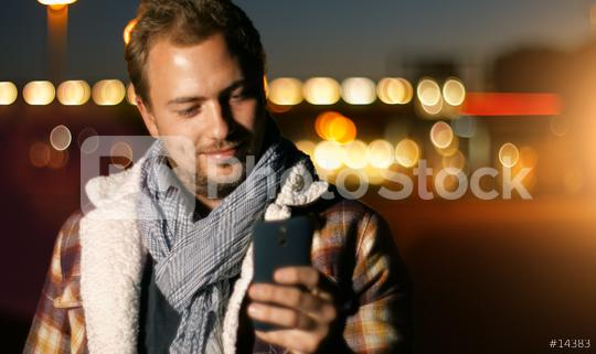 Handsome young man sms texting using app on smart phone at autum /summer sunset in city  : Stock Photo or Stock Video Download rcfotostock photos, images and assets rcfotostock   RC-Photo-Stock.:
