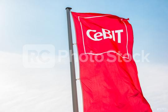 HANNOVER, GERMANY MARCH, 2017: Cebit sign on a flag against blue sky. The Cebit is the biggest trade fair for information technology in the world.  : Stock Photo or Stock Video Download rcfotostock photos, images and assets rcfotostock | RC-Photo-Stock.: