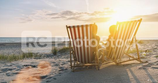 Happy Romantic Couple Enjoying Beautiful Sunset at the Beach and toasting with wine  : Stock Photo or Stock Video Download rcfotostock photos, images and assets rcfotostock | RC-Photo-Stock.: