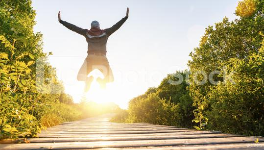 Happy young man jumping with raised hands and legs, and enjoying life over a Wooden jetty at sunset  : Stock Photo or Stock Video Download rcfotostock photos, images and assets rcfotostock | RC-Photo-Stock.: