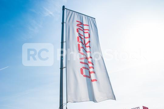 HERZOGENRATH, GERMANY MARCH, 2017: Aixtron flag against blue sky. The engineering company.produces equipment for the production of compound semiconductors and other multicomponent materials.  : Stock Photo or Stock Video Download rcfotostock photos, images and assets rcfotostock | RC-Photo-Stock.: